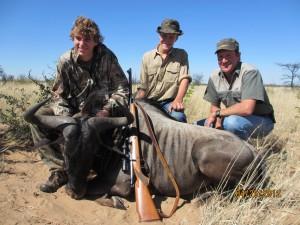 Darren, Mikea, and Aabram after the Wildebeeste hunt
