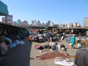 The traditional healer market below the modern city