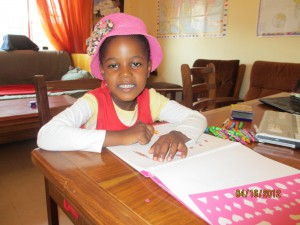 Praise is my counterparts cute cute daughter.  She is coloring a Barbie book