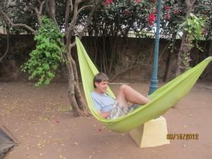 Adam relaxing in the hamak
