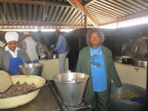 This is the indoor kitchen - that is sunlight at the top of the walls.  Lunch is cooked for 850 children and 100 adults here.