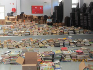 They put all the books in one huge school gym and then we sort through them.