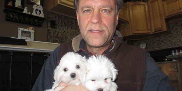 John with Pula and her sister at 6 weeks